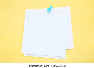 Paper sticky note on yellow wooden table