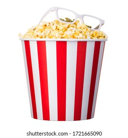 Paper striped bucket with popcorn and 3D glasses isolated on white background with clipping path. Concept of cinema or watching TV.