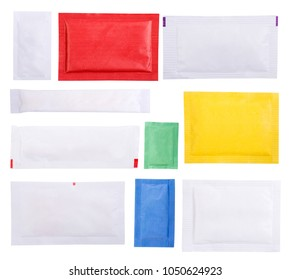 Paper sugar sachets isolated on white background