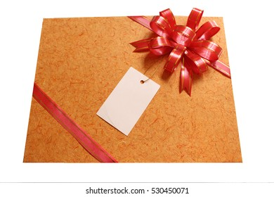 paper tag on the present with ribbon with selective on the ribbon concept of Christmas and new year gift