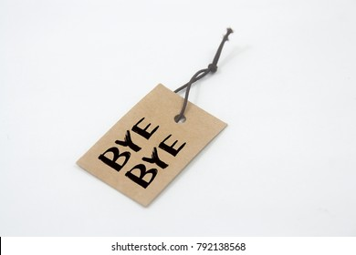 paper tag written bye-bye over white background