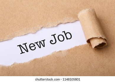 Paper tear with the word New Job.
