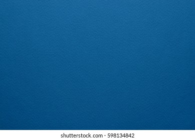 Paper texture background. High quality Grain texture in a high resolution. Deep blue color. Fine arts paper.