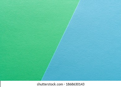 Paper texture background of pastel green and blue colors. Sheets of blank light green and light blue paper with fine texture devided  by a sloping border.