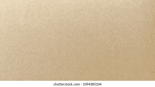 Paper texture - brown kraft sheet background. Textured paper surface.