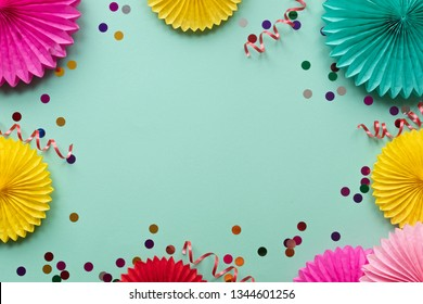 Paper texture flowers on green background. Birthday, holiday or party background. Flat lay style.