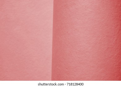 Paper texture. Indian handmade paper. Color toning. Paper in roles. Pink.