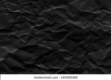 Paper texture, a sheet of black wrinkled paper