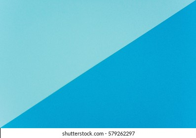 Paper textured background has two colors, dark and light blue. Background with diagonal line
