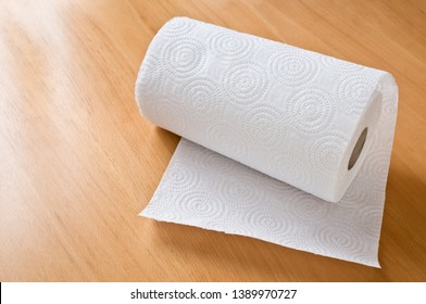 Paper towel roll on wooden the table.