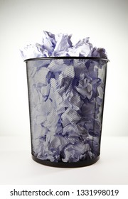 Paper and wastebasket.