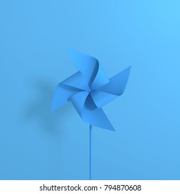 Paper windmill isolated on blue background. minimal style