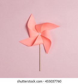 paper windmill Isolated on pink background
