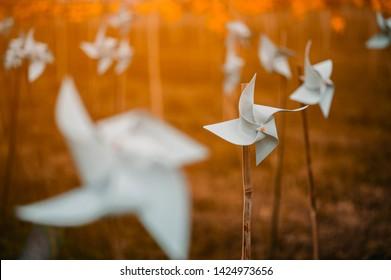 Paper windmills in green grass field.paper windmills.