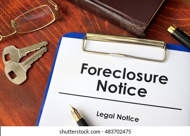 Paper with words Foreclosure Notice on a wooden surface.