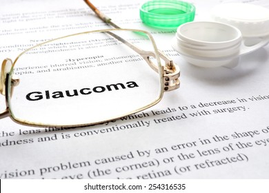 Paper with words  glaucoma, glasses and container for lenses. Selective focus.