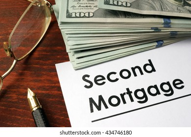 Paper with words second mortgage.