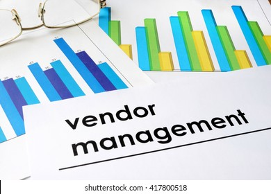 Paper with words Vendor management and charts.