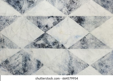 Paper wrinkled with black faded rhomboid shapes, background
