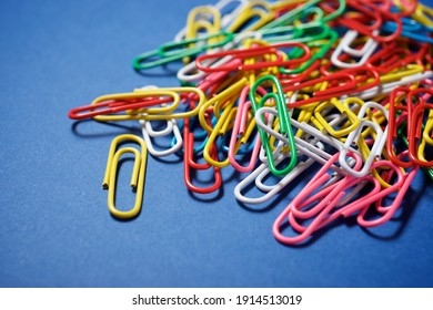 Paperclips group on a blue table.