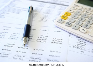 Papers of business financial statement with pen and calculator