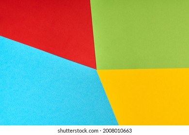 Papers in colors of famous computer corporation, software manufacturer logo. Red, green, blue, yellow paper colours. Corporation logo concept. Abstract background.