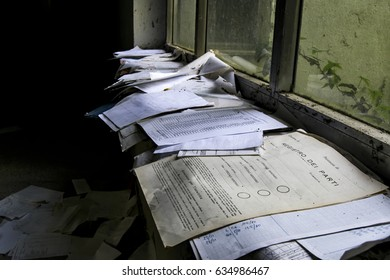 a lot of papers and documents scattered on a window sill of an abandoned psychiatric hospital. Vercelli-italy 28 april 2017