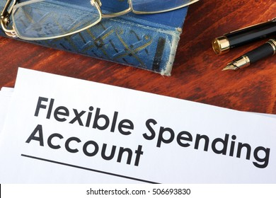 Papers with flexible spending account FSA on a table.