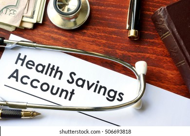 Papers with Health on a table.Savings Account HSA on a table.