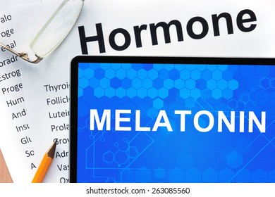 Papers with hormones list and tablet  with word melatonin.