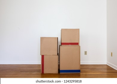 Paper`s moving  boxes on wooden floor in empty room