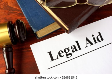 Papers with title legal aid on a table.