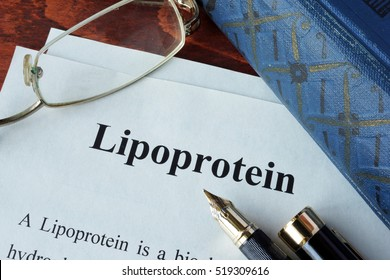 Papers with word lipoprotein on a table.
