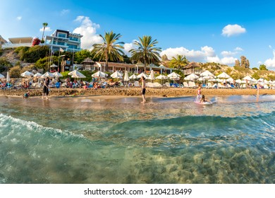 PAPHOS, CYPRUS - August 20, 2017: People relaxing at Coral Bay Beach one of the most famous beaches in Cyprus.