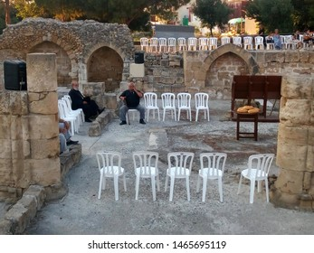 Paphos, Cyprus - June 29, 2019: Arrangement for the liturgy on the Apostle Paul feast day among the  ruins of a gothic temple beside the Panagia Chrysopolitissa church