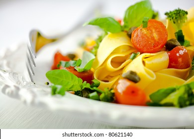 Pappardelle pasta with vegetables and capers