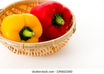 Paprika. Bell pepper on bamboo colander