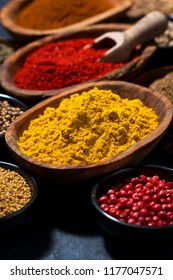 paprika, turmeric, red pepper and other oriental spices, closeup, vertical