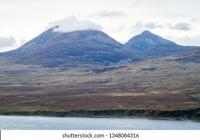 The Paps of Jura, large mountains on the island of Jura in Scotland, are seen from the island of Islay, Scotland.