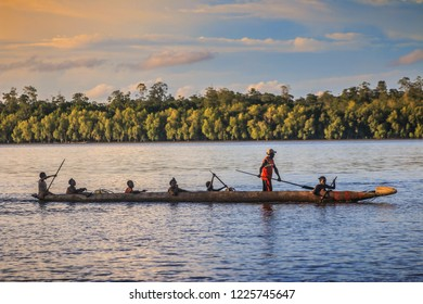 PAPUA, INDONESIA - FEBRUARY 10, 2018 : Asmat native people use the waters as a place to find fish. photo documentation of Residents in Asmat Area, Papua, Indonesia.