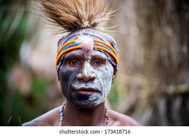 PAPUA NEW GUINEA - OCTOBER 25: A Kaia Tribe member in traditional clothing and face paint in Kaip Village in Papua New Guinea on October 25, 2013.