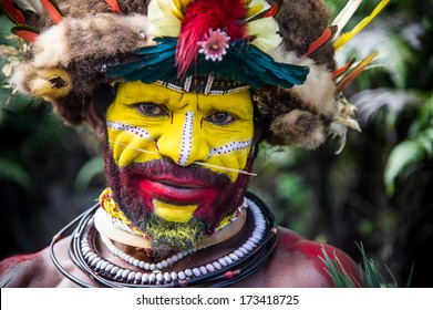 PAPUA NEW GUINEA - OCTOBER 30: The men of the Huli tribe in Tari area of Papua New Guinea in traditional clothes and face paint on October 30, 2013.