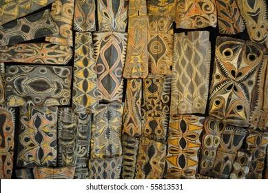Papua New Guinea shields arranged as a ceiling.