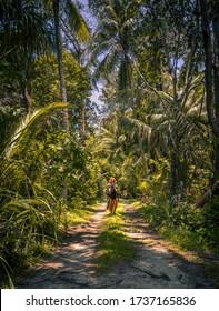 Papua New Guinea Tribesman in Jungle Landscape on Conflict Island