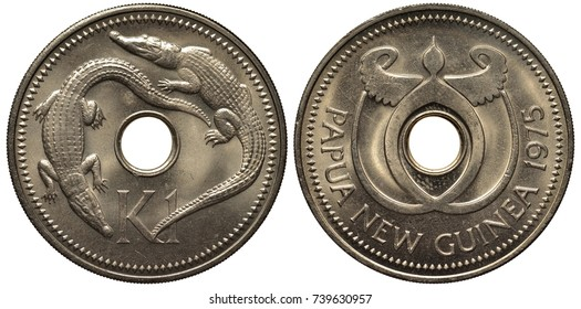 Papua-New Guinea coin 1 kina 1975, crocodiles flank center hole, symbolic design around center hole,