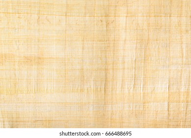 Papyrus paper, abstract texture background. Papyrus is an ancient Egypt writing surface / media, created from strips of the pith found inside the stalk laid down in layers and dried under pressure.