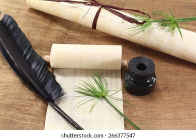Papyrus scroll with plant, quill and inkwell