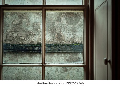 Par of an old window frame with wooden shutters