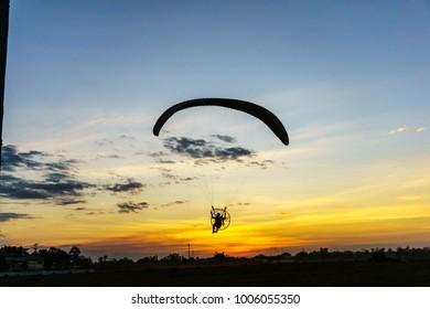 Para glider on the sunset sky.