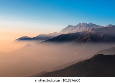 Para gliding across the Dhauladhar range above Bir biilling, Asia's highest flying spot
